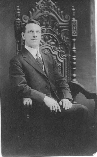 Photographic portrait  of Frank T. Bretherton, seated.