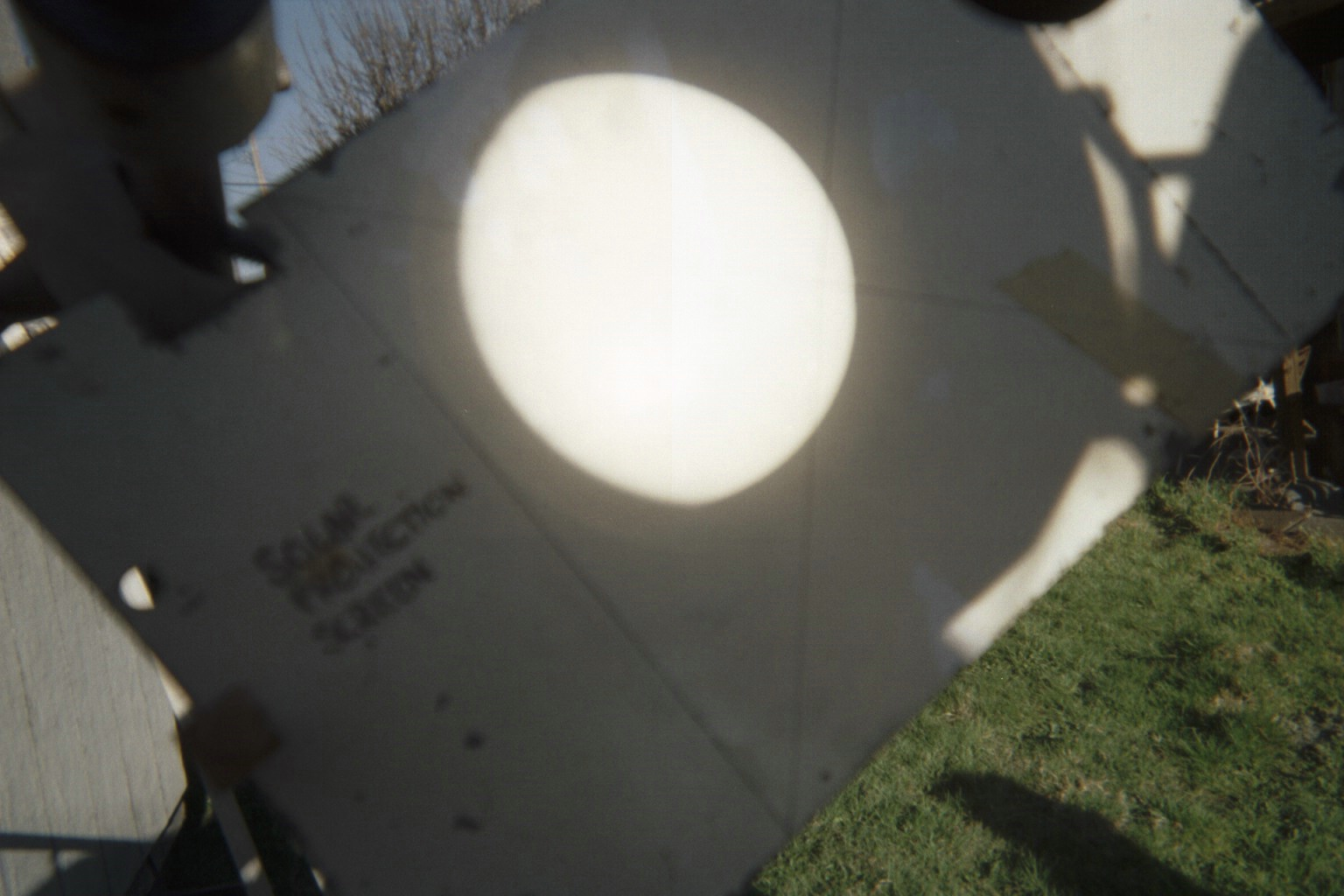 Solar eclipse image, projected on a white card